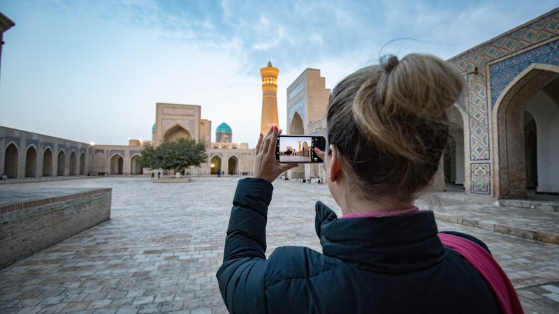 Traveller takes photo of Kalon Minaret
