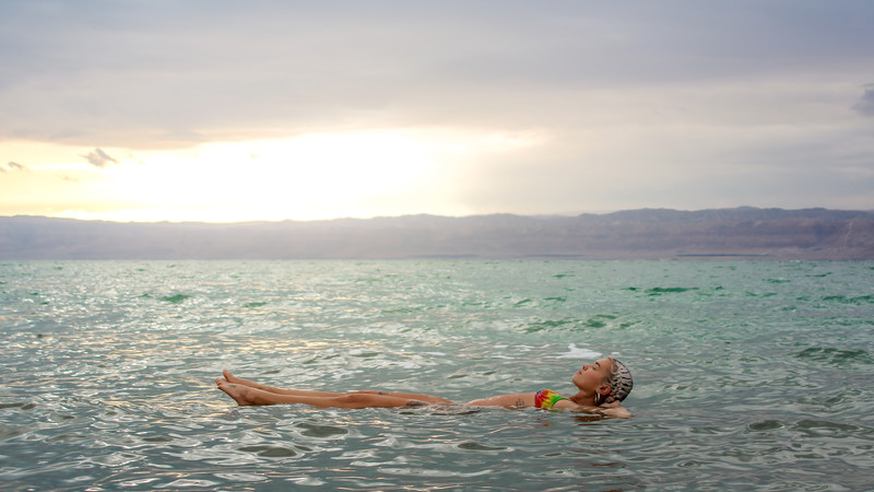 A woman floats on the Dead Sea