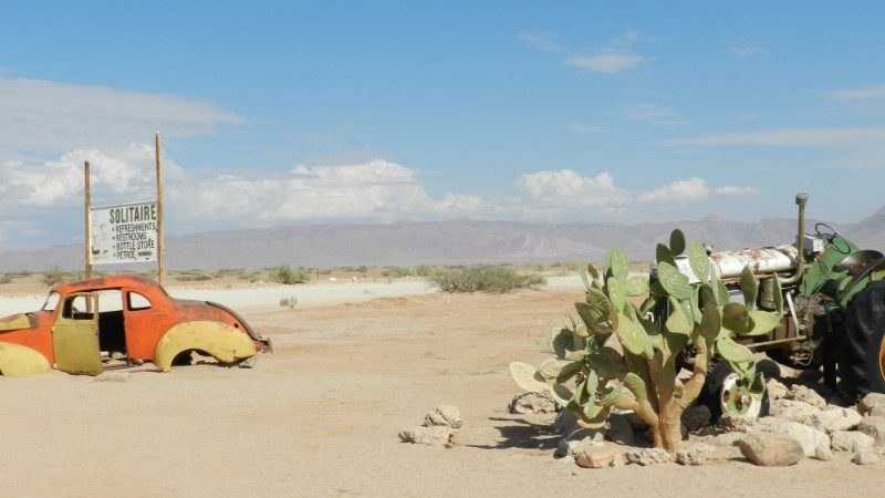 Abandoned car and a cactus in Solitaire, Namibia