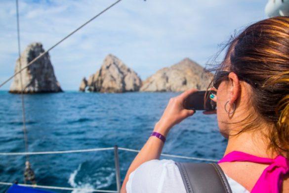 Woman taking photo of wildlife
