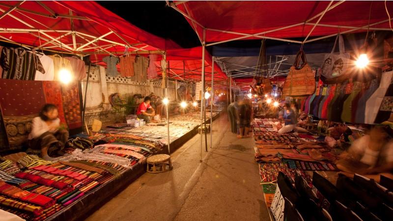 Sellers set up their stalls in Luang Prabang