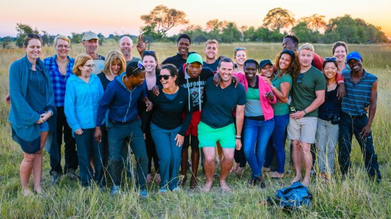 A group of happy travellers in Botswana
