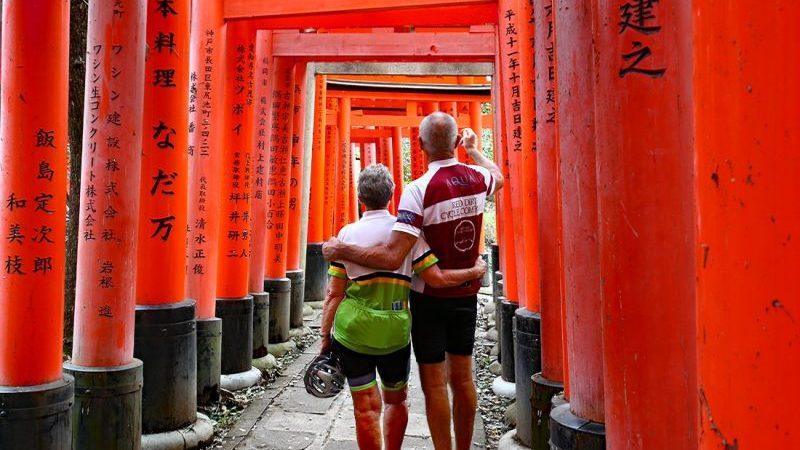 Two cyclists in the Fushimi Inari-Taisha shrine