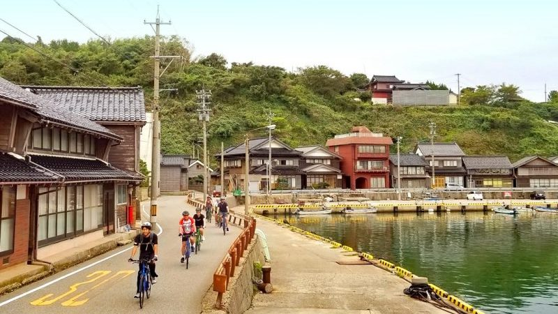 Cyclists in a small town in Japan