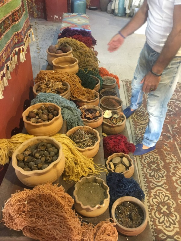 The yarn and natural dyes used for weaving.