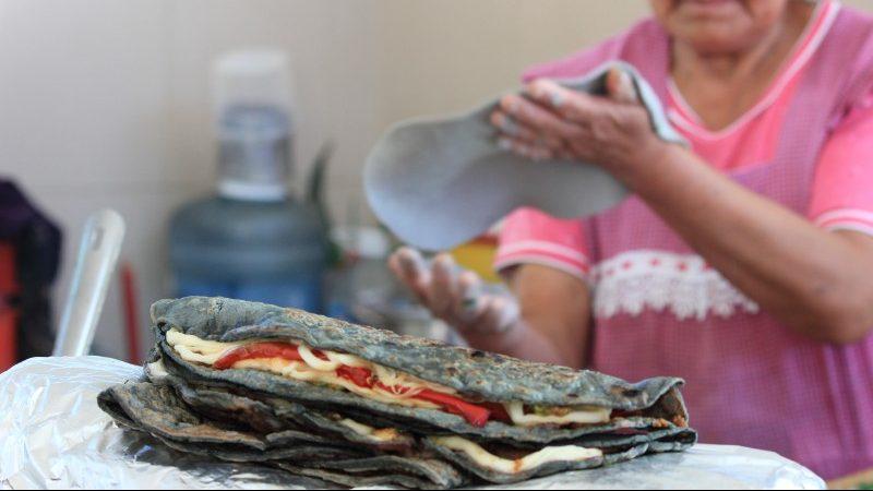 A woman making quesdillas