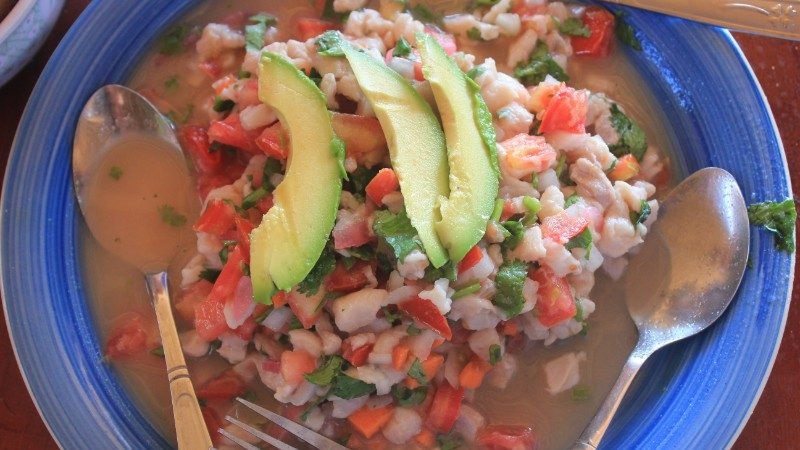 A bowl of ceviche and avocado