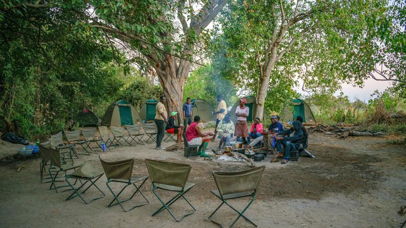 Travellers sitting around at a bush campsite