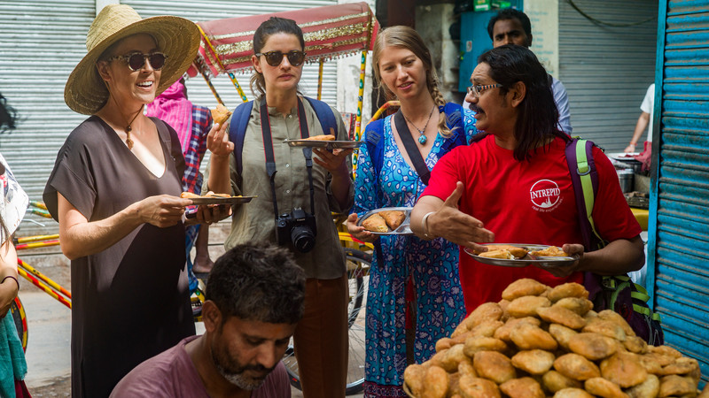 Four people eating street food in India