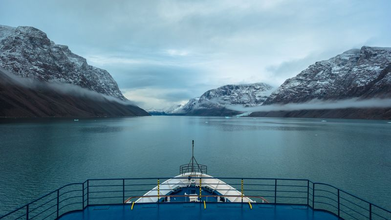 A ship sails through the Arctic