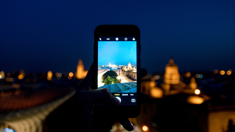 Taking a photo in Seville at night