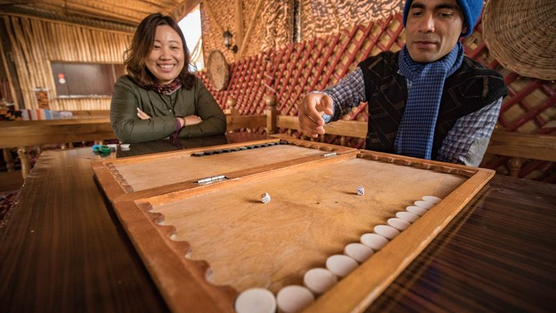 travellers play local board game