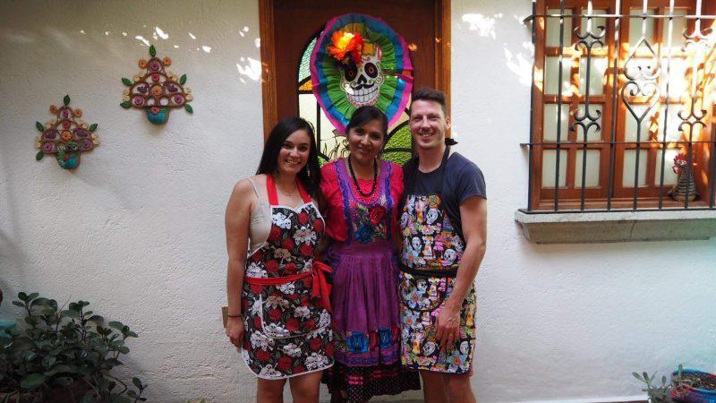 Three people wearing aprons.