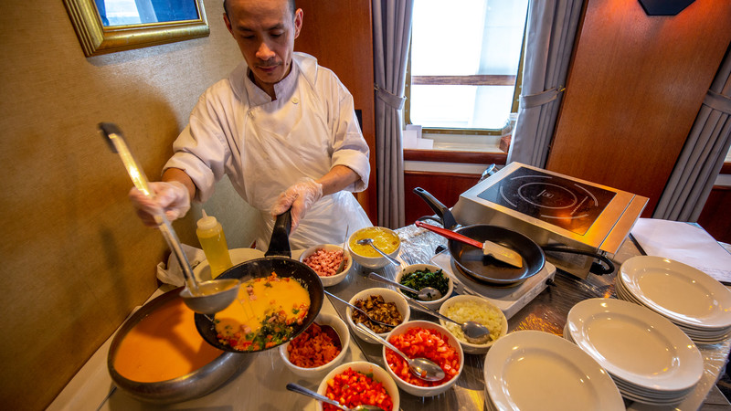 A chef prepares to cook an omelette
