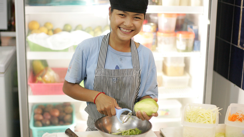 Woman working in kitchen in Cambodia