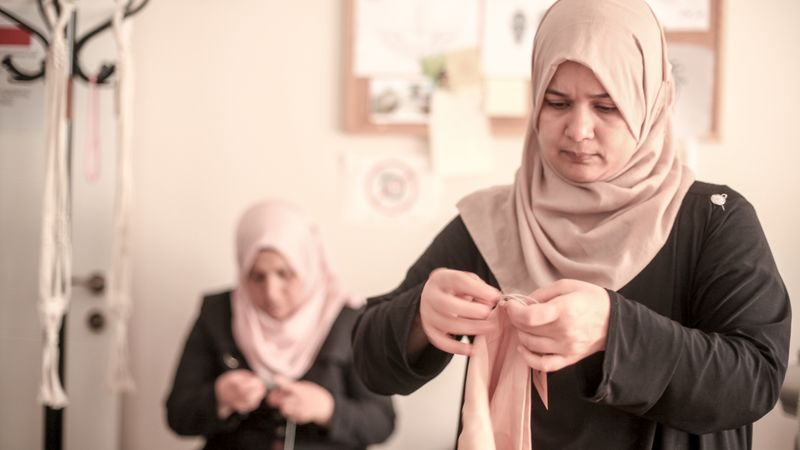 A woman learning to sew in Turkey
