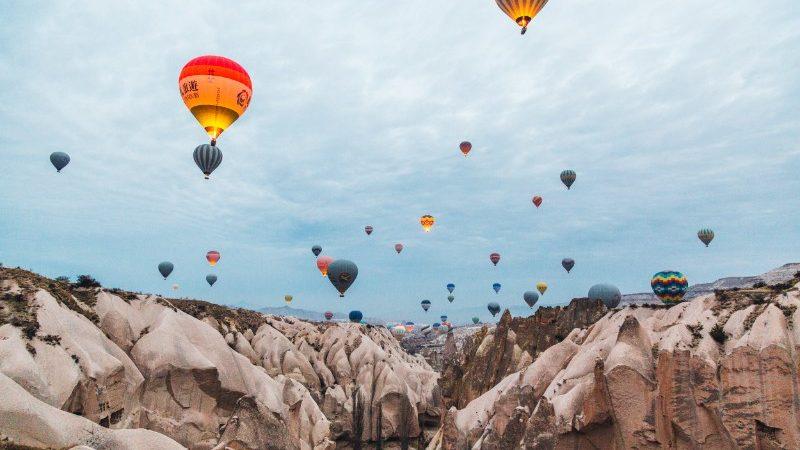 Hot air balloons above valley in Cappadocia