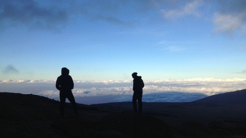 Two hikers on top on Mt Kilimanjaro