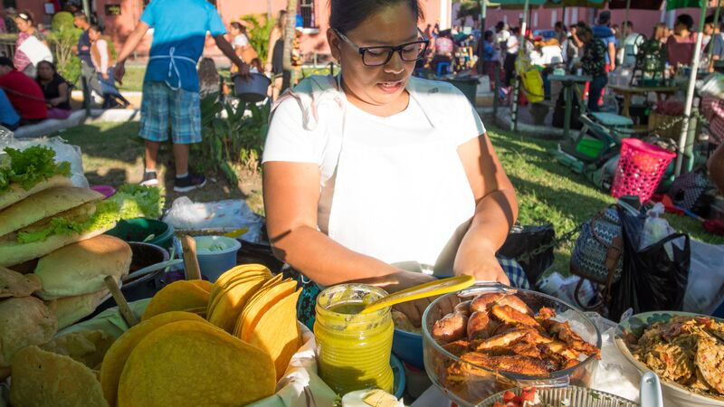 A woman preparing food at a market
