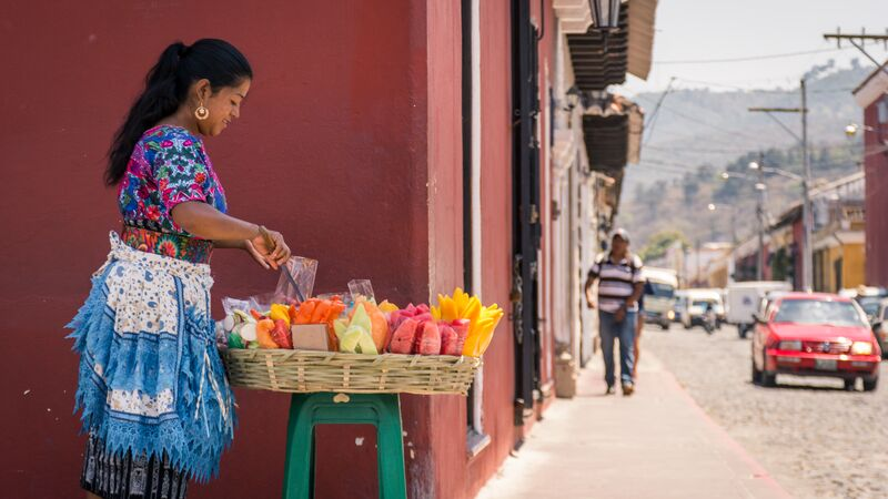 A woman selling flowers in Antigua