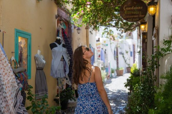 Girl walking through Santorini laneways