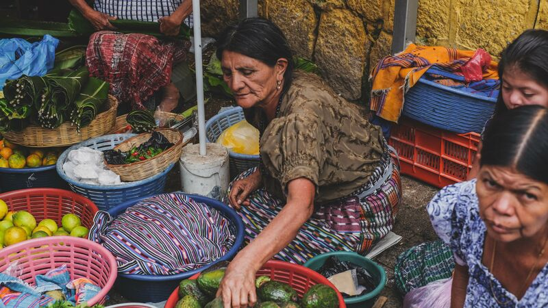A woman selling vegetables at the market