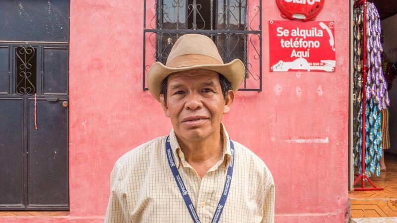 A man in a cowboy hat in Lake Atitlan