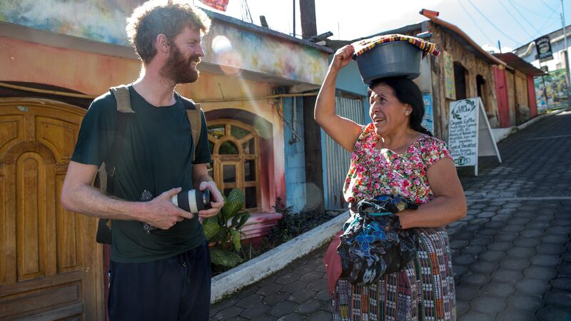 A traveller chats to a local in Guatemala