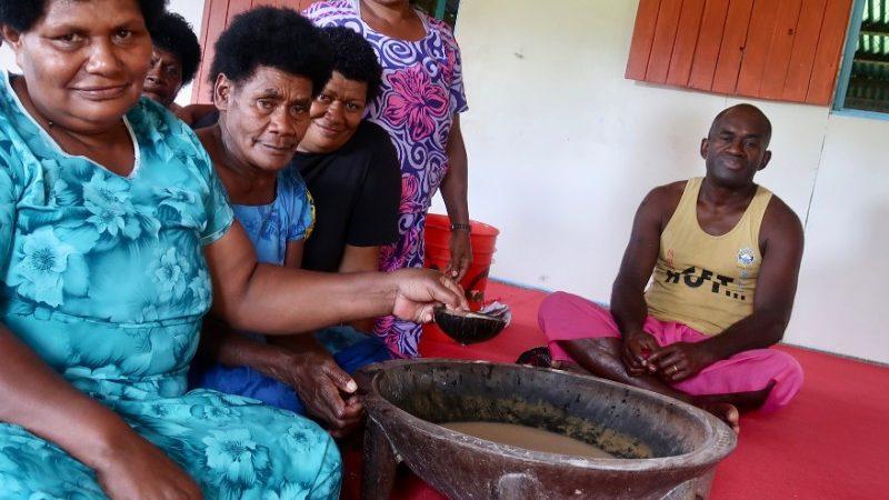 Fijians sitting around a kava bowl