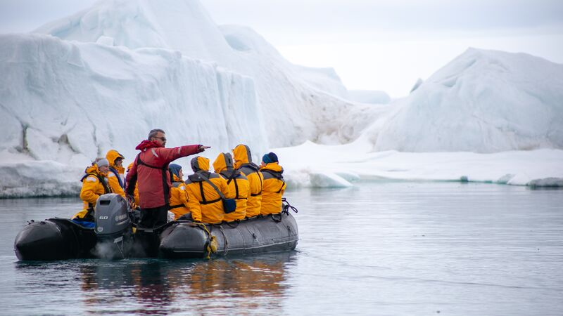 Travellers on a Zodiac in the Arctic