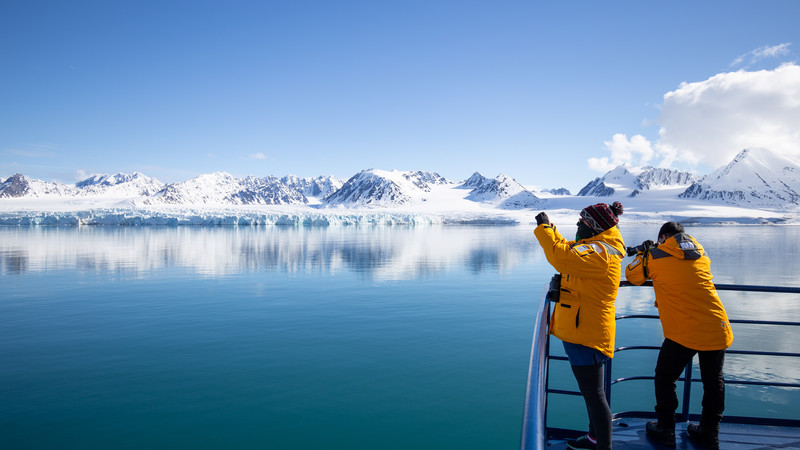 Arctic travellers take photo of landscape