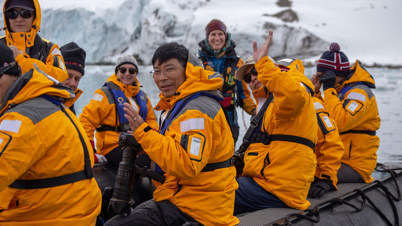 Travellers in the Arctic on a Zodiac