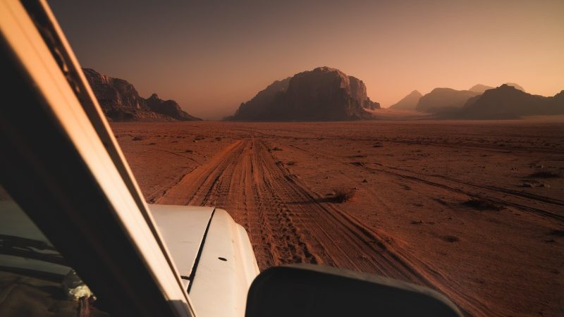 The front of a car driving through the desert