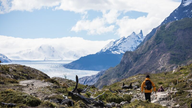 A trekker in a yellow jacket in Patagonia
