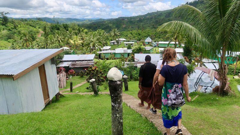 Travellers in a small village in Fiji