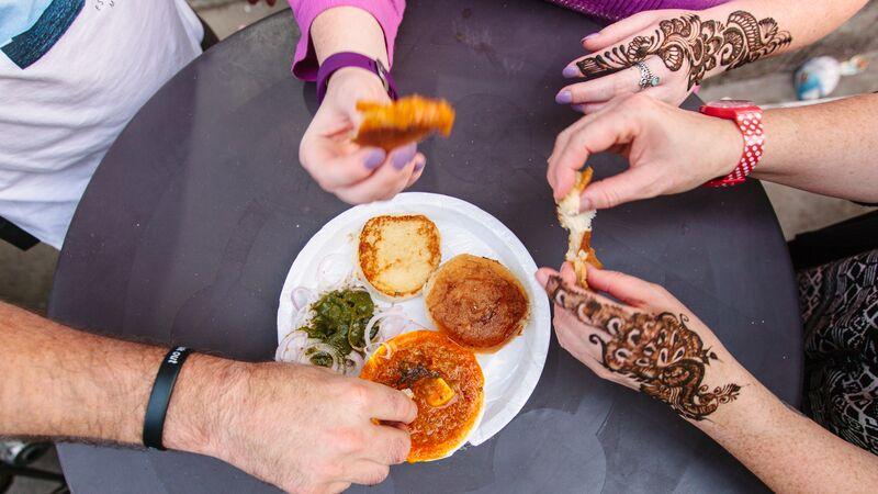 People eating street food in India