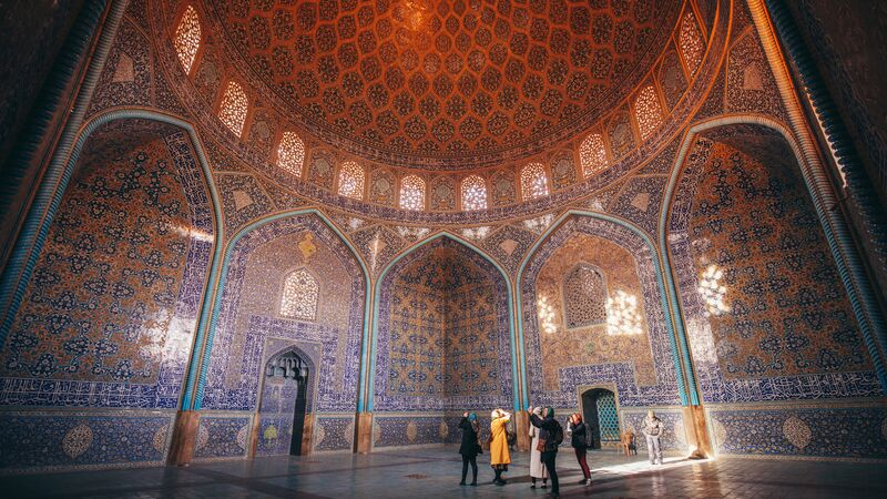 A group of female travellers in a beautiful mosque in Iran