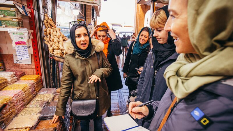 A group of female travellers at the market in Iran