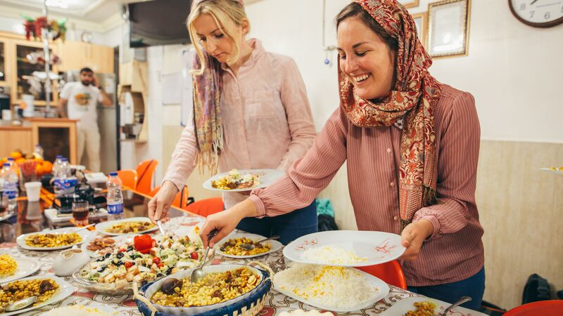 Two happy women at a cooking class in Iran