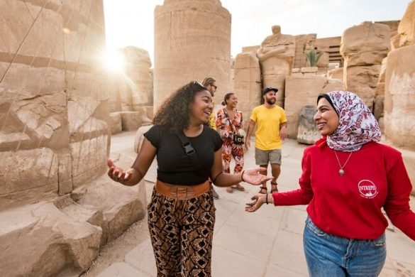 A tour guide shows a traveller around Egypt