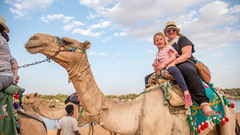 A mum and her daughter on a camel in Egypt