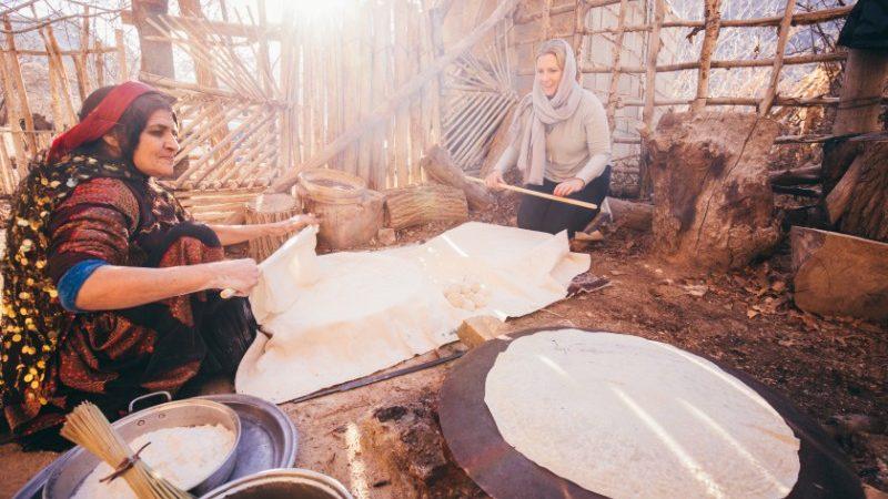 Three women making bread