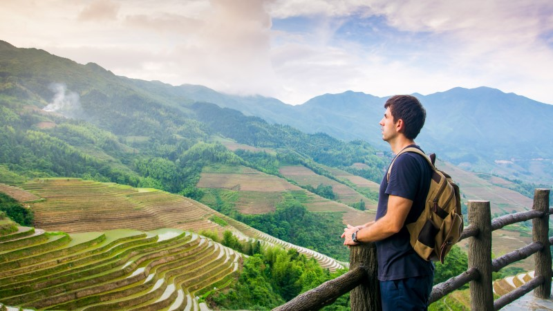 Traveller looks out over the Longji Terraces in China