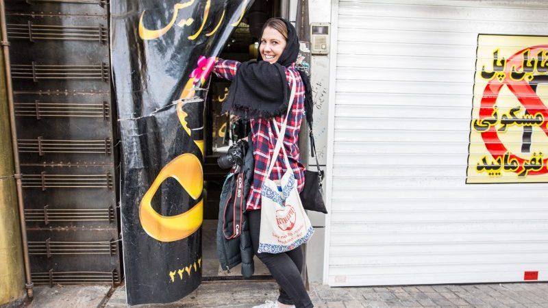 A woman enters a salon in Iran