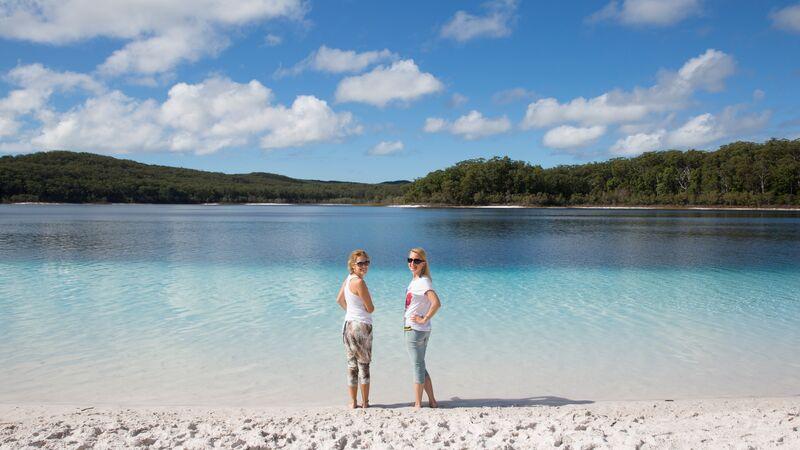 Two women wade in a beautiful bay