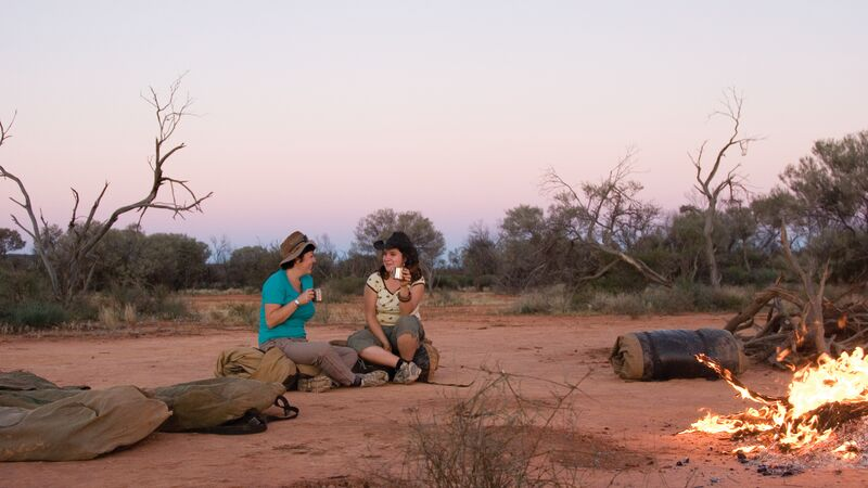 Two women drinking tea in the outback