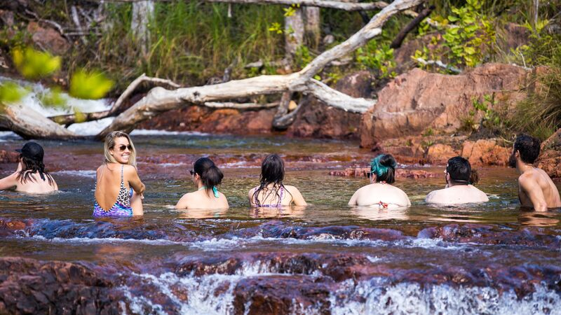 A group of swimmers in a rockpool in Litchfield.
