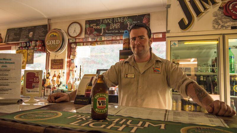 A man serves a beer in a pub
