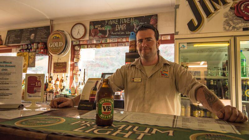 A man serves a beer in a pub