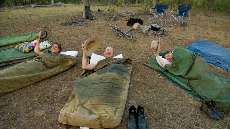 Travellers sleeping in swags.